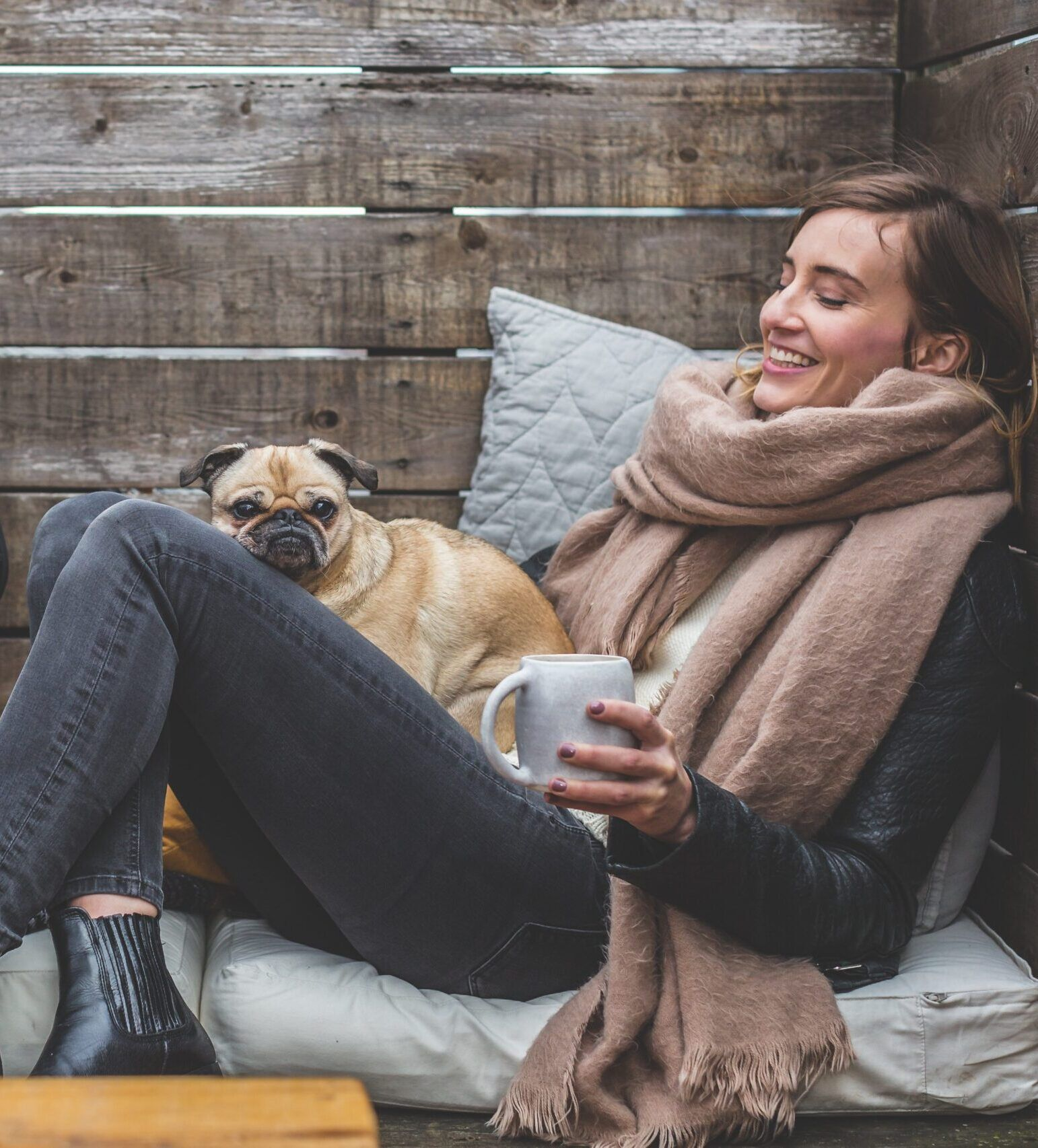 pet parent with dog outside in winter