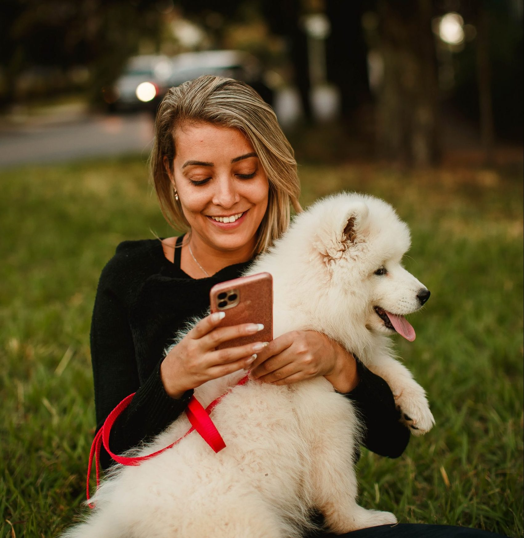 Woman on phone with fluffy dog